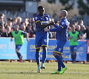 Wimbledon defender DEJI OSHILAJA scores a goal to make it 1-0 during the Sky Bet League 2 match between AFC Wimbledon and York City at the Cherry Red Records Stadium, Kingston, England on 7 March 2015.