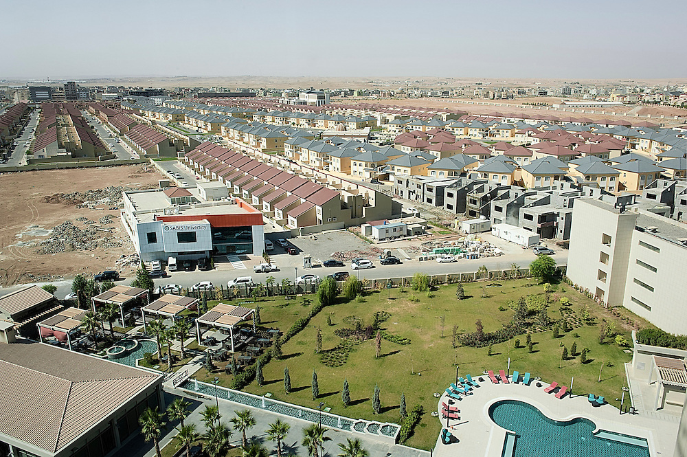 Erbil, Iraqi Kurdistan. The English and the Italian village, viewed from the top floor of the Rotana Hotel. The Kurdish Regional government is developing a new residential development in all the Kurdish region. The housing market is growing. People are looking for higher quality standards. Also, as more and more foreigners enter the country, the demand for international standards is growing for renting and purchasing.