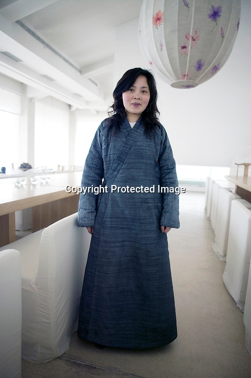 BEJING, MARCH 22:  Green T House Living .waitress dressed in Manchu robe