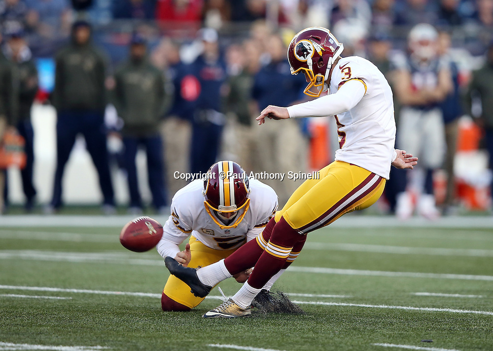 Washington Redskins punter Tress Way (5) holds while Washington Redskins kicker Dustin Hopkins (3) kicks a late fourth quarter extra point that cuts the New England Patriots lead to 27-10 during the 2015 week 9 regular season NFL football game against the New England Patriots on Sunday, Nov. 8, 2015 in Foxborough, Mass. The Patriots won the game 27-10. (©Paul Anthony Spinelli)