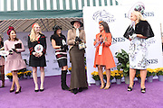 Lisa Biederman, center, of Versailles, KY, reacts after winning the Longines Prize of Elegance contest at the 2015 Breeders' Cup at Keeneland Racecourse on Friday, Oct. 30, 2015 in Lexington, KY.  Longines, the Swiss watch manufacturer known for its elegant timepieces, is the Official Watch and Timekeeper of the Breeders' Cup World Championships and the Triple Crown. (Photo by Diane Bondareff/Invsion for Longines/AP Images)