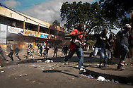 Widespread street protests swept the Haitian capital of Port-au-Prince after preliminary election results were announced the night before. Those protesting accused the government of staging a fraudulent election.