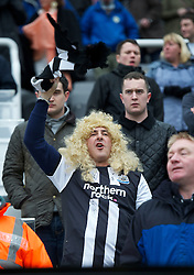 NEWCASTLE, ENGLAND - Sunday, March 4, 2012: A Newcastle United supporter wearing a women's wig before the Premiership match against Sunderland at St. James' Park. (Pic by David Rawcliffe/Propaganda)