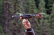 Filmmaker Scott Rulander retrieves a DJI Mavic Pro drone after a videography session in the Purcell Mountains of northwest Montana.
