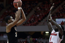 "20 March 2017:  A.J. Davis shoots over Daouda ""David"" Ndiaye (4) during a College NIT (National Invitational Tournament) 2nd round mens basketball game between the UCF (University of Central Florida) Knights and Illinois State Redbirds in  Redbird Arena, Normal IL"