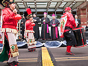 """03 DECEMBER 2011 - PHOENIX, AZ:    Bishop THOMAS OLMSTED (center) blesses dancers honoring the Virgin of Guadalupe in Phoenix. The Phoenix diocese of the Roman Catholic Church held its Sixth Annual Honor Your Mother Day Saturday to honor the Virgin of Guadalupe. According to Mexican Catholic tradition, on December 9, 1531 Juan Diego, an indigenous peasant, had a vision of a young woman while he was on a hill in the Tepeyac desert, near Mexico City. The woman told him to build a church exactly on the spot where they were standing. He told the local bishop, who asked for some proof. He went back and had the vision again. He told the lady that the bishop wanted proof, and she said """"Bring the roses behind you."""" Turning to look, he found a rose bush growing behind him. He cut the roses, placed them in his poncho and returned to the bishop, saying he had brought proof. When he opened his poncho, instead of roses, there was an image of the young lady in the vision. The Virgin is now honored on Dec 12 in Catholic churches throughout Latin America and in Hispanic communitied in the US.   PHOTO BY JACK KURTZ"""
