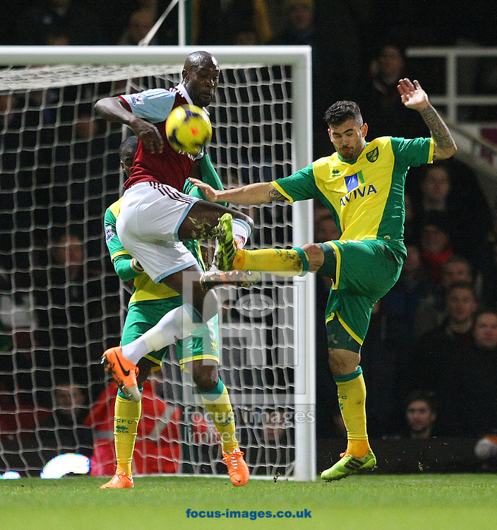 Picture by Paul Chesterton/Focus Images Ltd +44 7904 640267<br /> 11/02/2014<br /> Bradley Johnson of Norwich and Carlton Cole of West Ham in action during the Barclays Premier League match at the Boleyn Ground, London