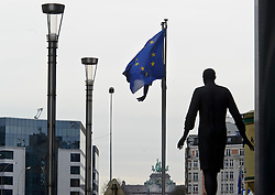 EU flags fly next to the European Council headquarters, in Brussels, Belgium, on Monday, Dec. 19, 2011. (Photo © Jock Fistick).