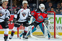 KELOWNA, BC - DECEMBER 18: Justin Sourdif #42 of the Vancouver Giants looks for the pass as Roman Basran #30 of the Kelowna Rockets defends the net at Prospera Place on December 18, 2019 in Kelowna, Canada. (Photo by Marissa Baecker/Shoot the Breeze)