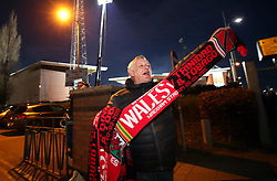 A Wales fan shows his support outside the ground prior to the International Friendly match at the Racecourse Ground, Wrexham.