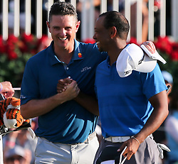 September 22, 2018 - Atlanta, Georgia, United States - Justin Rose (L) hugs Tiger Woods on the 18th green after the third round of the 2018 TOUR Championship. (Credit Image: © Debby Wong/ZUMA Wire)