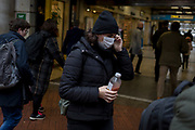 As the Coronovirus pandemic takes hold across the UK, with health authorities reporting cases rising from 25 to 87 in a single day, and resulting in the UK's chief medical officer Prof Chris Whitty announcing that an epidemic in the UK was 'highly likely', a woman wearing a surgical mask passes-by Evening Standard headlines outside Embankment Underground station, on 4th March 2020, in London, England.