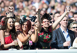 LIVERPOOL, ENGLAND, Thursday, April 7, 2011: Racegoers cheer their horse on during Ladies' Day on Day Two of the Aintree Grand National Festival at Aintree Racecourse. (Photo by David Rawcliffe/Propaganda)