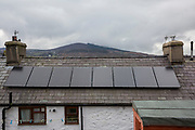 Solar PV panels on the roof of a house placed by Energy Local in Bethesda, Gwynedd, Wales. Energy Local is a company that works to change the electricity market and for small communities to give them more sustainable energy resources. (photo by Andrew Aitchison / In pictures via Getty Images)
