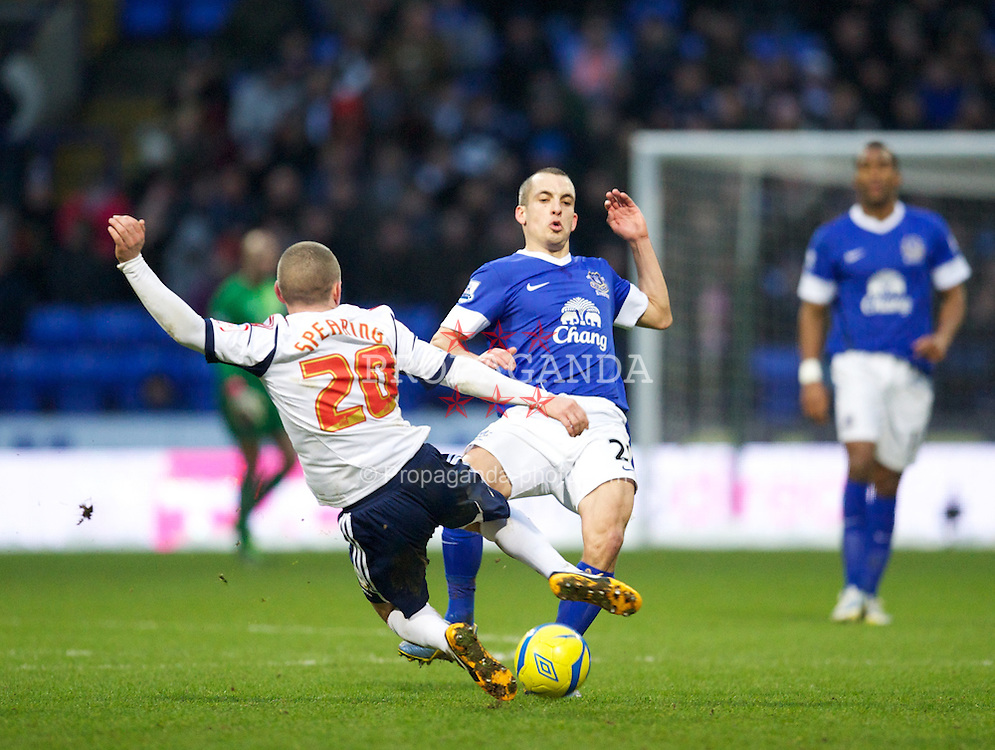 BOLTON, ENGLAND - Saturday, January 26, 2013: Everton's Leon Osman in action against Bolton Wanderers' Jay Spearing during the FA Cup 4th Round match at the Reebok Stadium. (Pic by David Rawcliffe/Propaganda)