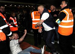A Swindon United fan clashes with a Sheffield United fan - Photo mandatory by-line: Dougie Allward/JMP - Mobile: 07966 386802 - 11/05/2015 - SPORT - Football - Swindon - County Ground - Swindon Town v Sheffield United - Sky Bet League One - Play-Off