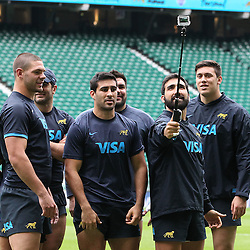 Argentina players take photos of themselves at Twickenham after the Argentina Captains Run at Twickenham Stadium, Twickenham - 07/10/2016<br />