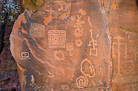 Sinagua petroglyph panel of geometric and anthropomorphic design at V Bar V Heritage Site in Coconino National Forest near Sedona, Arizona.