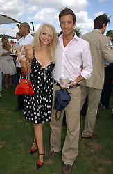 HANNAH SANDLING and OLIVER FELSTEAD at the Cartier International polo at Guards Polo Club, Windsor Great Park, on 30th July 2006.<br />