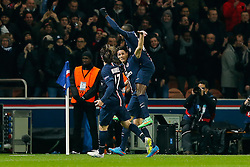 Edinson Cavani of Paris Saint-Germain celebrates with Maxwell and Blaise Matuidi after he scores a goal to make it 1-1 - Photo mandatory by-line: Rogan Thomson/JMP - 07966 386802 - 17/02/2015 - SPORT - FOOTBALL - Paris, France - Parc des Princes - Paris Saint-Germain v Chelsea - UEFA Champions League, Last 16, First Leg.