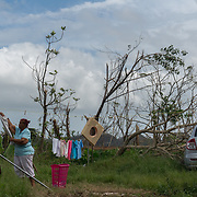 OCTOBER 18 - LARES, PUERTO RICO - <br /> A woman hangs clothes to dry on an empty lot  in Lares one month after  the destructive path of hurricane Maria.<br /> (Photo by Angel Valentin for NPR)