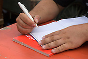 hands of a male person writing