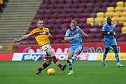3rd November 2018, Fir Park, Motherwell, Scotland; Ladbrokes Premiership football, Motherwell versus Dundee; Calvin Miller of Dundee challenges for the ball with Liam Grimshaw of Motherwell