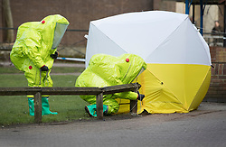 © Licensed to London News Pictures. 08/03/2018. Salisbury, UK. Firefighters in hazardous material suits adjust a police tent covering a park bench next to The Maltings shopping centre in Salisbury where Former Russian spy Sergei Skripaland his daughter Yulia were found after being poisoned with nerve agent. The couple where found unconscious on bench in Salisbury shopping centre. Authorities continue to investigate. Photo credit: Peter Macdiarmid/LNP