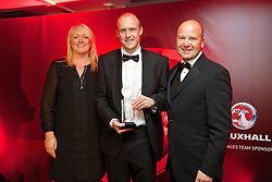 CARDIFF, WALES - Monday, October 6, 2014: The New Saints' Scott Ruscoe is presented with the Welsh Premier League Player of the Year Award by Chief-Executive Jonathan Ford and Vauxhall's Cheryl Stibbs at the FAW Footballer of the Year Awards 2014 held at the St. David's Hotel. (Pic by David Rawcliffe/Propaganda)