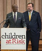 Ken Huewitt comments during a Children at Risk awards presentation to area schools as Dr. Robert Sanborn listens at Pilgrim Academy, June 6, 2016.