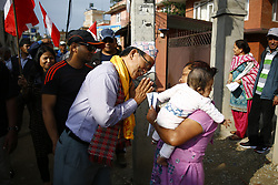 May 9, 2017 - Lalitpur, Nepal - A Nepali Congress party candidate gestures to a woman during the election campaign of Nepali Congress party candidates for the upcoming elections in Lalitpur, Nepal on Tuesday, May 09, 2017. The local elections are scheduled to be held after a period of 20 years on May 14, 2017. (Credit Image: © Skanda Gautam via ZUMA Wire)