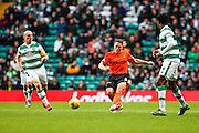 Dundee United Midfielder John Rankin plays the forward ball during the Ladbrokes Scottish Premiership match between Celtic and Dundee United at Celtic Park, Glasgow, Scotland on 25 October 2015. Photo by Craig McAllister.