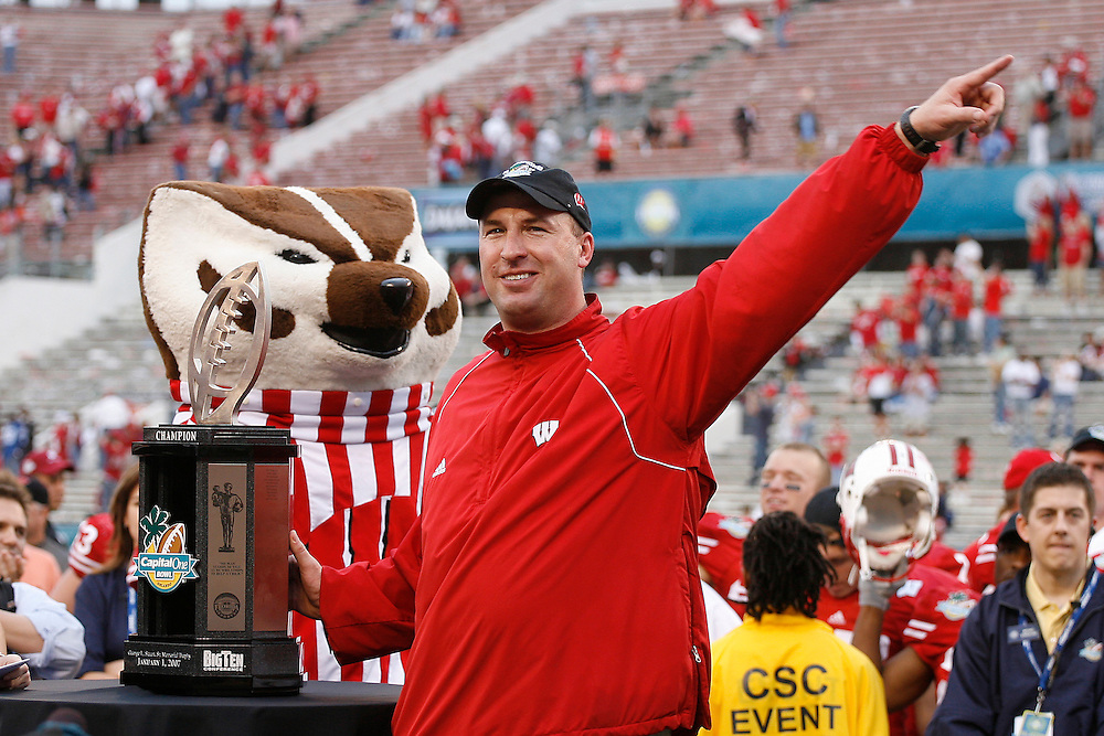 University of Wisconsin head coach Bret Bielema celebrates with the Capital One Bowl trophy after the Wisconsin Badgers 17-14 victory over the Arkansas Razorbacks on January 1, 2007 at the Florida Citrus Bowl Stadium in Orlando, Florida.