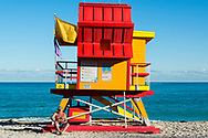 Man sitting on life guard stand on South Beach, Miami, Monday, December 11, 2017. (©2017 Wendelin Ray Photography)