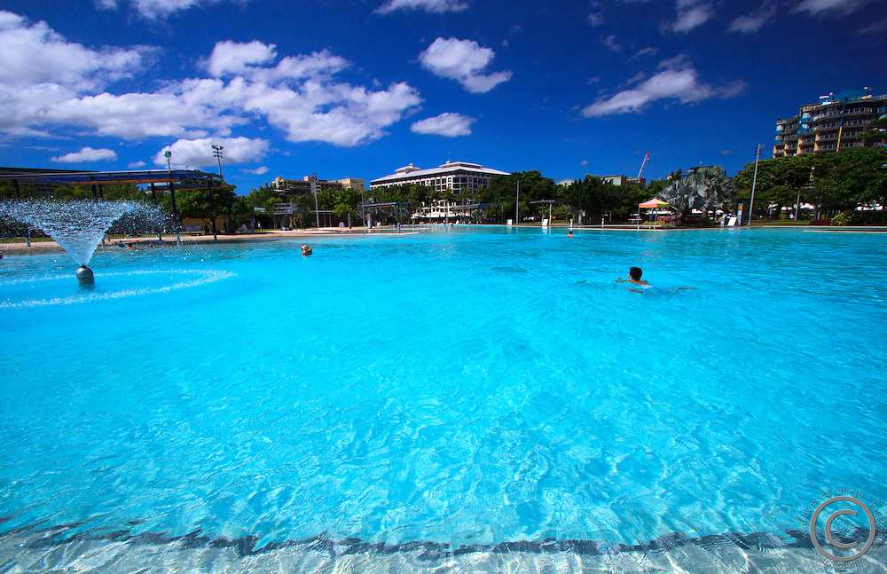 The cool, clear waters of the Cairns Esplanade Lagoon provide a welcome escape from the heat of tropical far north Queensland, Australia