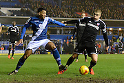 Birmingham City midfielder David Davis and Brentford defender Jake Bidwell battle during the Sky Bet Championship match between Birmingham City and Brentford at St Andrews, Birmingham, England on 2 January 2016. Photo by Alan Franklin.