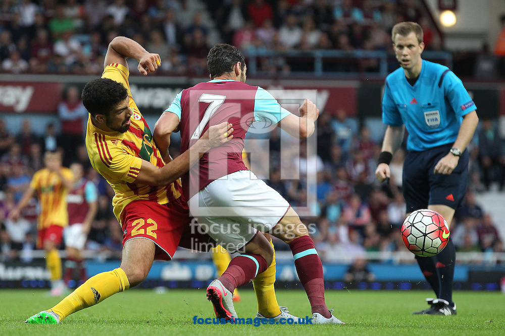 Zach Muscat of Birkirkara FC and Matt Jarvis of West Ham in action during the UEFA Europa League match at The Boleyn Ground, London<br /> Picture by Paul Chesterton/Focus Images Ltd +44 7904 640267<br /> 16/07/2015