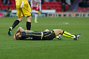 Bristol Rovers Midfielder Stuart Sinclair on the floor after being fouled by Doncaster Rovers Forward John Marquis (9) during the EFL Sky Bet League 1 match between Doncaster Rovers and Bristol Rovers at the Keepmoat Stadium, Doncaster, England on 27 January 2018. Photo by Craig Zadoroznyj.