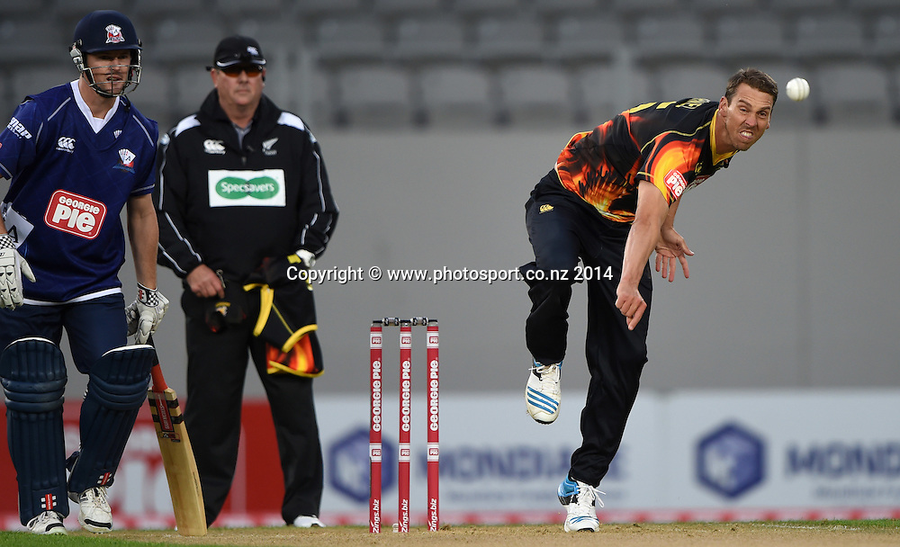 Brent Arnel bowling during the Georgie Pie Super Smash Twenty20 cricket match between the Auckland Aces and Wellington Firebirds at Eden Park, Auckland on Friday 14 November 2014. Photo: Andrew Cornaga / www.Photosport.co.nz