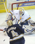 Lake Superior State goaltender Pat Inglis stares down a shot from Notre Dame's Riley Sheahan Friday night in Sault Ste. Marie.