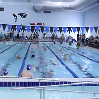 Competitors warm-up Saturday for the Southern Zone Swimming at the Tupelo Aquatic Center