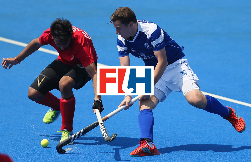 LONDON, ENGLAND - JUNE 20:  Alan Forsyth of Scotland and Sukhi Panesar of Canada battle for the ball during the Pool B match between Scotland and Canada on day six of the Hero Hockey World League Semi-Final at Lee Valley Hockey and Tennis Centre on June 20, 2017 in London, England.  (Photo by Alex Morton/Getty Images)