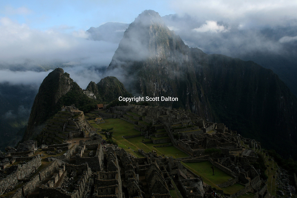 An early morning view of the ruins of the lost Inca city of Machu Picchu in Peru, on August 12, 2007. Machu Picchu was recently voted one of the new Seven Wonders of the World. Some experts are concerned if the site can maintain the large number of tourists that visit the site and are worried that if proposals to increase the number of visitors will have adverse effects on the ancient ruins. (Photo/Scott Dalton)