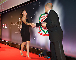 CARDIFF, WALES - Monday, October 5, 2015: Wales' Natasha Harding is presented with the Fans Favourite Award by FAW Chief-Executive Jonathan Ford during the FAW Awards Dinner at Cardiff City Hall. (Pic by David Rawcliffe/Propaganda)
