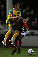 Photo: Paul Thomas.<br /> Rotherham United v Norwich City. Carling Cup. 19/09/2006.<br /> <br /> Ian Henderson (L) of Norwich jumps into Colin Cochraine.