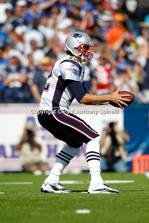 New England Patriots quarterback Tom Brady (12) catches a shotgun snap during the NFL week 3 football game against the Buffalo Bills on Sunday, September 25, 2011 in Orchard Park, New York. The Bills won the game 34-31. ©Paul Anthony Spinelli