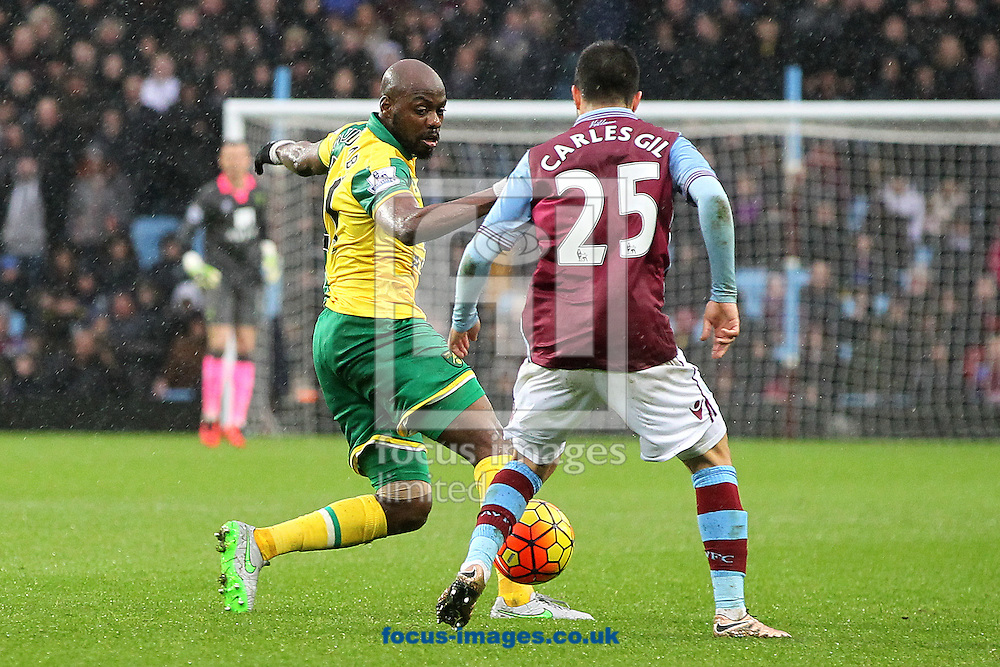 Youssouf Mulumbu of Norwich and Carles Gil of Aston Villa in action during the Barclays Premier League match at Villa Park, Birmingham<br /> Picture by Paul Chesterton/Focus Images Ltd +44 7904 640267<br /> 06/02/2016