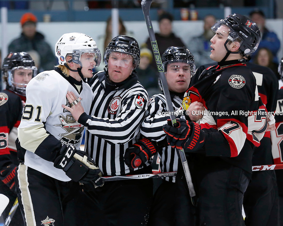 TRENTON, ON - MAR 3,  2017: Ontario Junior Hockey League, playoff game between the Trenton Golden Hawks and the Newmarket Hurricanes., Mac Lewis #91 of the Trenton Golden Hawks and Francesco Luca #7 of the Newmarket Hurricanes get into an altercation<br /> (Photo by Amy Deroche / OJHL Images)