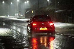 © Licensed to London News Pictures. 29/01/2019. STOKE MANDEVILLE, UK.  A car drives through light snow near Stoke Mandeville station. Rain is expected to turn to snow across large parts of the south of England and the Met Office has issued a yellow warning of snow and ice overnight.  Photo credit: Cliff Hide/LNP