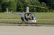 Montgomery, NY - A pilot gets ready to take off in his Robinson R22 Beta helicopter at Orange County Airport on July 26, 2008.